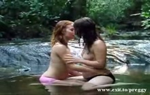 Preggo girl making out with a lesbian girl in the creek
