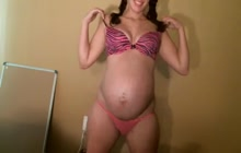 Pregnant lady with big belly on webcam