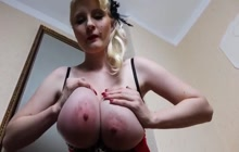 Pregnant blonde shows off her big boobs