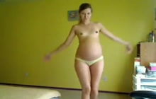Cute pregnant brunette shows off her naked body
